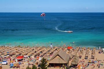 Resort Sunny Beach Bulgaria panorama of the beach in summer. Panoramic top view Sunny Beach Bulgaria. The boat and a parachute into the sea.