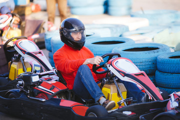 Young Man Is Driving Go-Kart