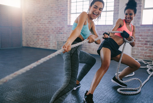 Two women doing intense workout at gym