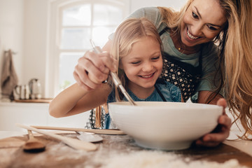 Young family cooking in kitchen