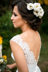 portrait of beautiful bride in wedding dress with a beautiful bouquet of flowers