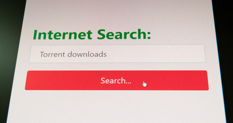 Torrent downloads - software piracy and illegal downloads concept