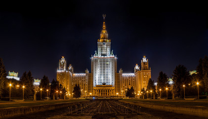 Large photo of Moscow State University of Russia at night. Clear night view on a tall famous educational building in Moscow. White illuminated university facade famous among the student.