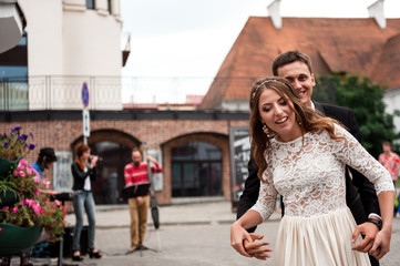 gorgeous happy wedding couple walking and kissing in the old city of Minsk, Belarus