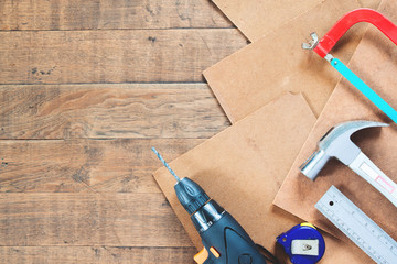 Flat lay set of carpenter equipments on wood background