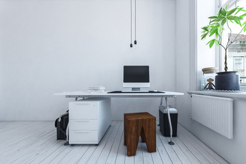 Simple workspace in a modern white room