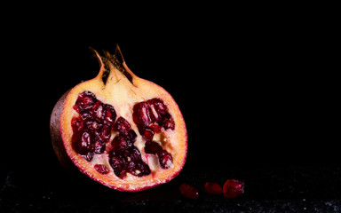 pomegranate isolated with black  background