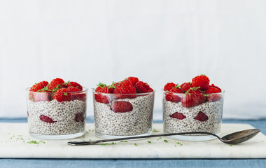 Portions of strawberry, seed and yoghurt dessert