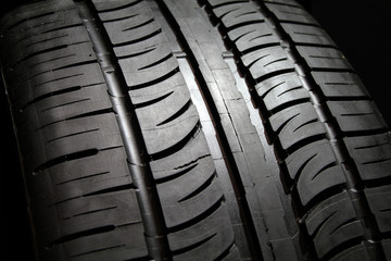 Close image of tire tread patterns on new tires.