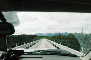 View of a bridge seen through a car windshield