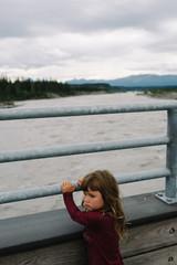 Unhappy young girl on bridge, Kennecott, National Park, Alaska