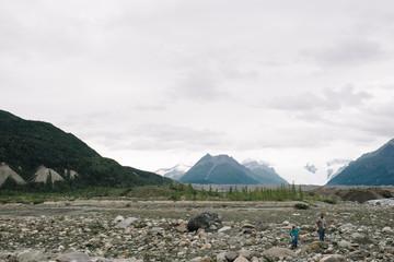 Two children exploring rocks, National Park, Alaska, North America