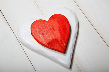 Heart on a white wooden background. St. Valentine's Day