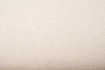Крафт бумага текстура. Бежевая бумага. Мятая упаковочная бумага фон.