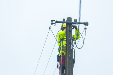 Electrician working on power lines