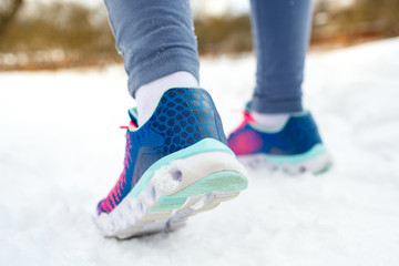 Runner getting ready for jogging outdoors in winter