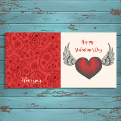 Greeting Valentine card with hand-drawn heart with wings on wooden background. Sketch. Hand-drawn, engraving, hatching