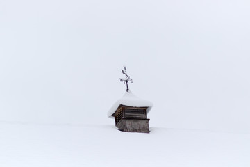 weather vane against a pale grey sky