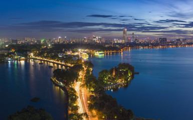 Hanoi skyline cityscape at twilight period. West Lake aerial view