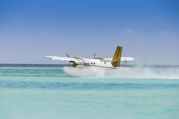 Seaplane taking off over ocean