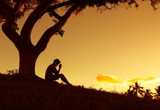 Young man praying.