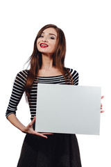 Long-haired beautiful cute brunette woman holding a rectangular blank-poster. white canvas with space for text.Red lips