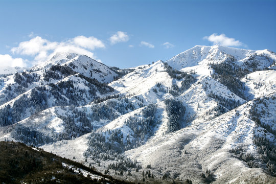 utah wasatch mountains in ogden just north of salt lake which is a popular vacation location for skiing snowboarding and winter sports