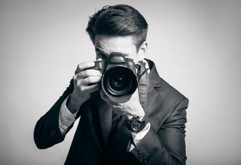 Male photographer taking pictures in studio.