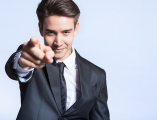 We want you! Making a choice concept. Businessman pointing his finger at camera.