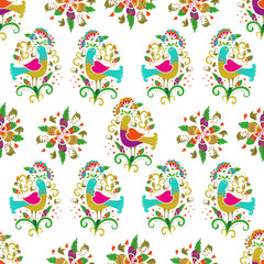 Colorful and ornate birds and flowers ethnic pattern. Seamless pattern on white background for embroidery and textile.