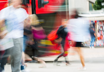 Lots of people walking in Oxford street, London. Blurred image.