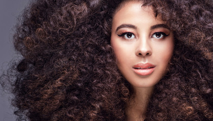 Beauty portrait of girl with afro.