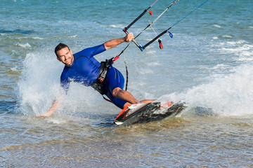Man smiling practicing kitesurfing