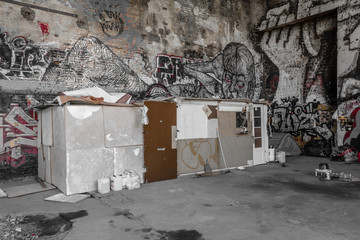 shelter of homeless people in abandoned factory building