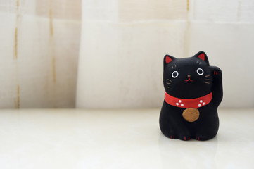 a lucky Japanese cat on blurred white background