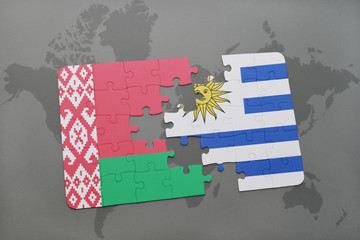 puzzle with the national flag of belarus and uruguay on a world map