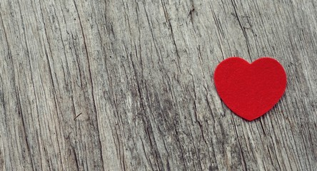 Red heart on wooden background vintage style