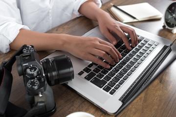 Photographer editing photos on laptop. Studio work, photo service concept. Workplace