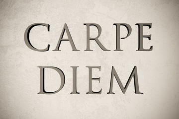 """Latin quote """"Carpe diem"""" on stone background, 3d illustration - meaning """"Seize the day"""""""