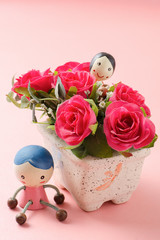 Red roses and couple doll on pink background,Valentine day concept
