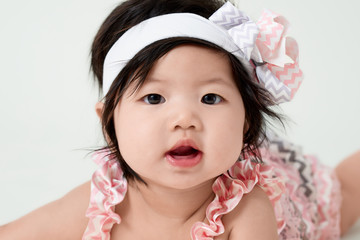 baby girl with cute floral dress and white background