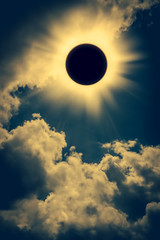 Natural phenomenon. Solar eclipse space with cloud on gold sky background