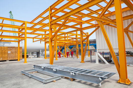 Yellow steel construction in open at factory.