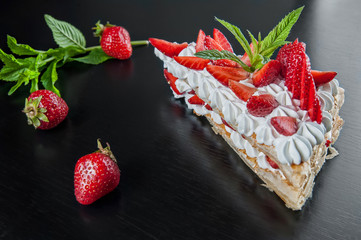 millefeuille dessert with strawberries and mint. Lies triangular