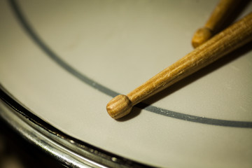 Snare drum and a pair of drum sticks