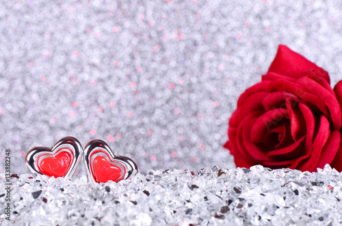 The Red Heart Shapes And Red Rose Flower On Abstract Light Silver