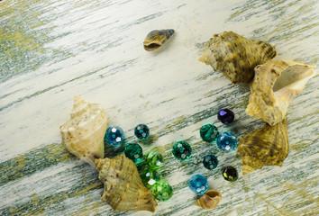 Bright blue beads and seashells.