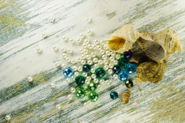 Blue beads, scattered pearl  and seashells.