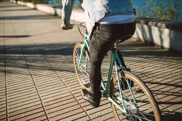 Casual young man riding his bicycle