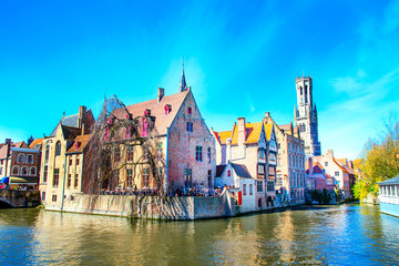 Scenic cityscape with medieval houses and tower Belfort and canal in Bruges, Belgium